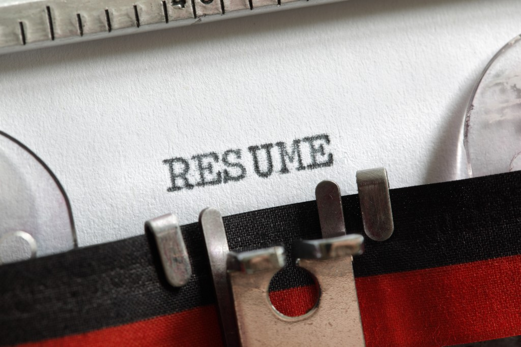 Resume vitae written on an old typewriter concept for job search and recruitment